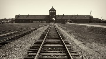 Main gate and railroad to nazi concentration camp of Auschwitz Birkenau